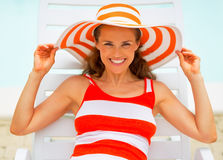 Portrait of smiling young woman laying on sunbed Stock Photography