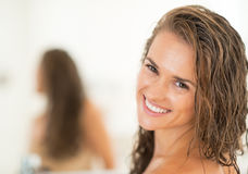Portrait of smiling young woman with long wet hair Royalty Free Stock Photos