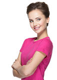 Portrait of a smiling young woman looking away. Isolated on white background Stock Images