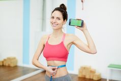 Smiling Woman Presenting Weightloss App stock photo