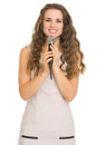 Portrait of smiling young woman with microphone Stock Photo