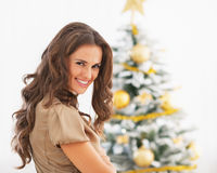 Portrait of smiling young woman near christmas tree Stock Image