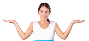 Portrait of a smiling young woman pointing up Royalty Free Stock Photo
