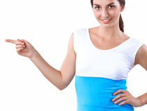 Portrait of a smiling young woman pointing up Royalty Free Stock Image