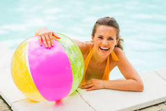 Portrait of smiling young woman in pool Royalty Free Stock Image