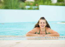 Portrait of smiling young woman in pool Stock Images
