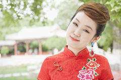 Portrait of Smiling Young Woman with Qipao Royalty Free Stock Images