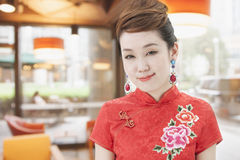 Portrait of Smiling Young Woman with Qipao Stock Photos