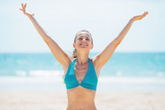 Portrait of smiling young woman rejoicing on beach Royalty Free Stock Image