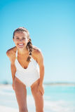 Portrait of smiling young woman at seaside Royalty Free Stock Photography