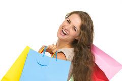 Portrait of smiling young woman with shopping bags Stock Images