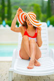 Portrait of smiling young woman sitting on sunbed Royalty Free Stock Photos