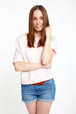 Portrait of smiling young woman standing Stock Photo