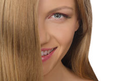 Portrait of smiling young woman with straight hair Stock Photos
