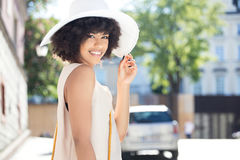 Portrait of smiling young woman. Stock Photo