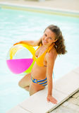 Portrait of smiling young woman in swimming pool Stock Images