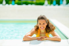 Portrait of smiling young woman in swimming pool Stock Photo