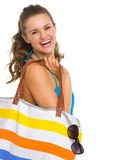 Portrait of happy woman in swimsuit with beach bag Royalty Free Stock Photography