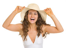Portrait of smiling woman in swimsuit and hat. Portrait of smiling young woman in swimsuit and hat Royalty Free Stock Photography