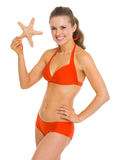 Portrait of smiling young woman in swimsuit starfish Stock Photos