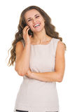 Portrait of smiling young woman talking mobile phone Stock Image