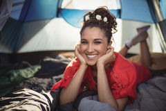 Portrait of smiling young woman in tent Royalty Free Stock Images