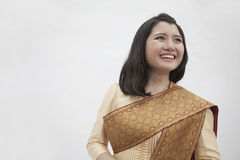 Portrait of smiling young woman in traditional clothing from Laos, studio shot Stock Image