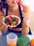 Portrait of smiling young woman with vegetarian vegetable salad Royalty Free Stock Image
