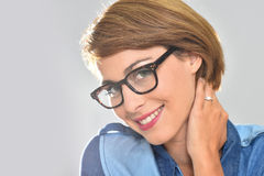 Portrait of smiling young woman wearing eyeglasses Stock Photography
