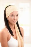 Portrait of smiling young woman wearing snood Stock Photo