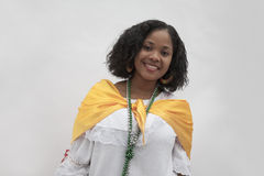 Portrait of smiling young woman wearing traditional clothing from the Caribbean, studio shot Stock Photo
