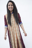 Portrait of smiling young woman wearing traditional clothing from Pakistan, studio shot Stock Images