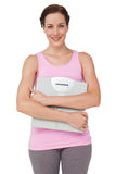 Portrait of a smiling young woman with weight scale Stock Photography
