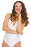 Portrait of smiling young woman in white bathrobe Royalty Free Stock Image