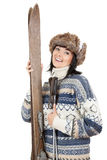 Old wooden skis and smiling young woman Stock Image