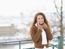 Portrait of smiling young woman in winter jacket outdoors Royalty Free Stock Image