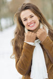 Portrait of smiling young woman in winter outdoors Royalty Free Stock Photo