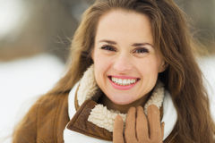 Portrait of smiling young woman in winter outdoors Royalty Free Stock Images