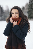 Portrait of smiling young woman in winter park. Stock Images