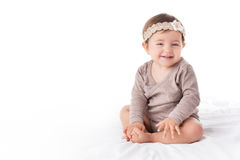 Portrait of a smilling baby girl on a white background Stock Images