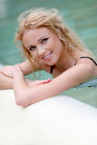Portrait of smilng woman in spa. Beautiful blond woman in swimming pool stock image