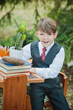 Portrait of a smily first-grader boy sitting at a desk Stock Images