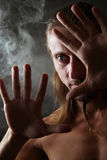 Portrait in a smoke Royalty Free Stock Photo