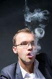 Portrait of a smoking businessman Stock Photography