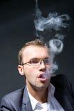 Portrait of a smoking businessman Stock Photography