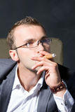 Portrait of a smoking businessman Royalty Free Stock Image