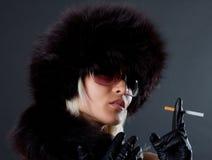 Portrait of smoking glam girl Royalty Free Stock Photo