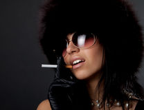 Portrait of smoking gorgeous woman Stock Images