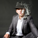 Portrait of the smoking man Stock Photography