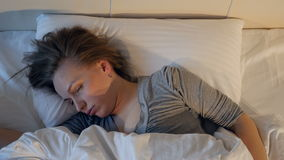 The portrait of the snoring woman. Close-up. 4K. stock video footage